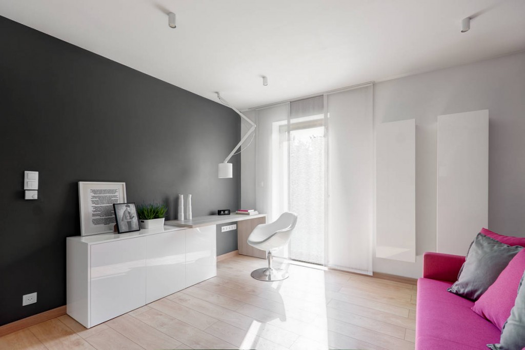 White working desk in a Contemporary Family House in Poland with Minimalist Touch