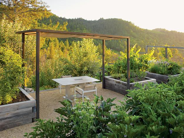 Outdoor dinning table with a fantastic view - 8 Trendy Garden Ideas for Eating, Playing and Relaxing