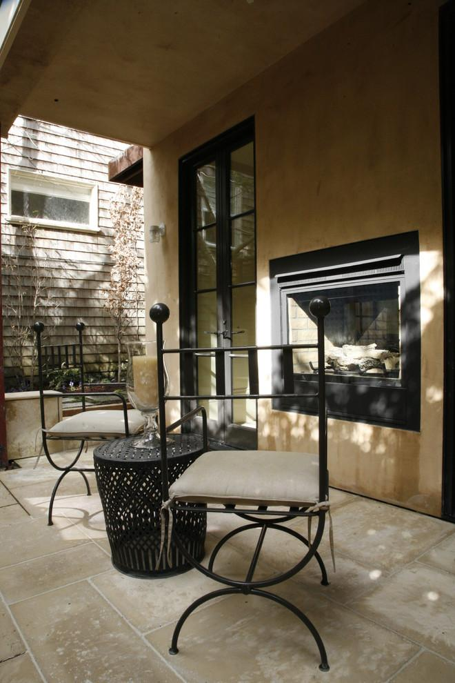 Outdoor patio with fireplace in Ashbury Heights, San Francisco