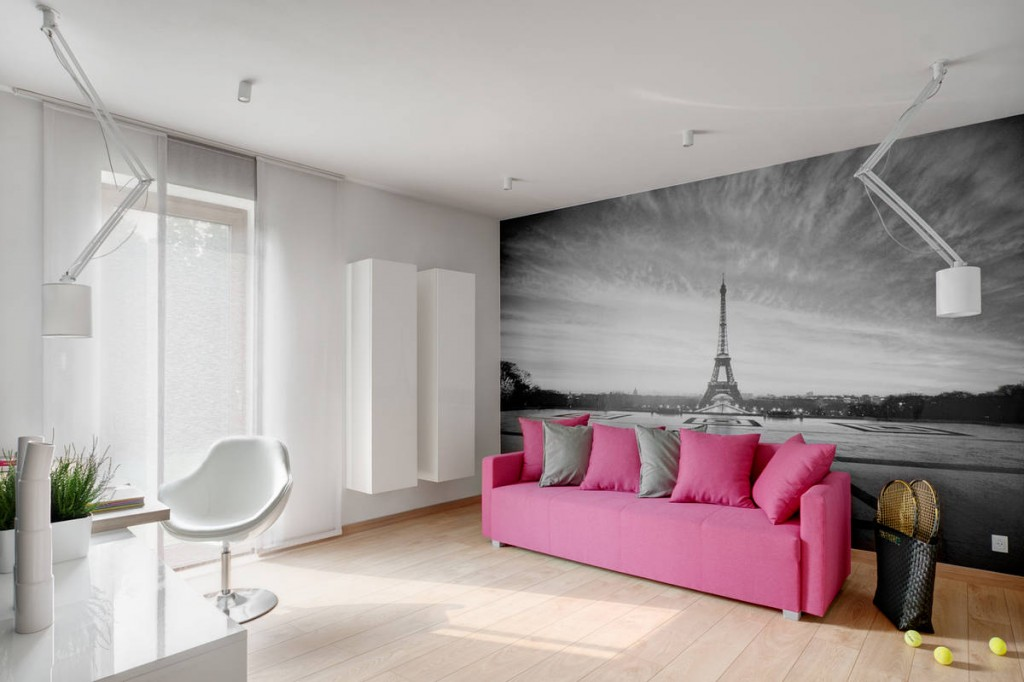 Pink sofa and decorative photo wallpaper of the Eifel Tower - Contemporary Family House in Poland with Minimalist Touch