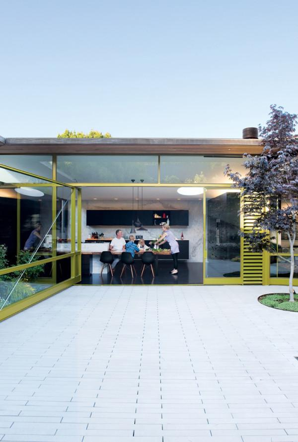 Pivot door – a Dwell photo by Dustin Aksland - 12 Leading to outdoor Patios Ideas and Examples