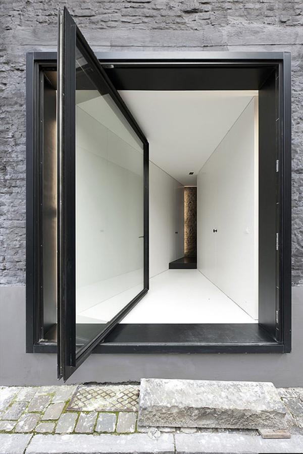 Pivot door designed by Graux Baeyens Architecten - 12 Leading to outdoor Patios Ideas and Examples