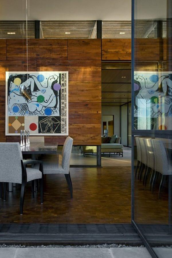 Pivot door in the dining room in Brown residence - 12 Leading to outdoor Patios Ideas and Examples