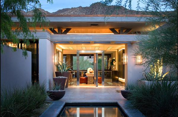 Pivot door by Harte Brownlee - 12 Leading to outdoor Patios Ideas and Examples