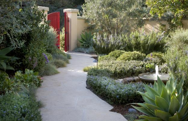 Red garden gate and stone path