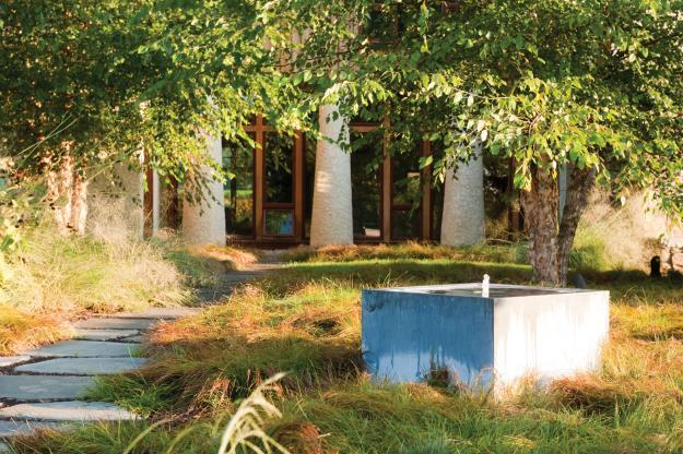 Small path leading to the main entrance - Sustainable House with Beautiful Outdoor Garden Areas