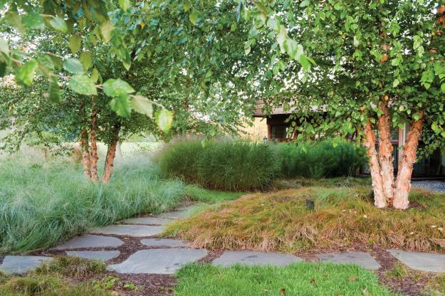 Stone Pieces Used As A Garden Path   Sustainable House With Beautiful  Outdoor Garden Areas