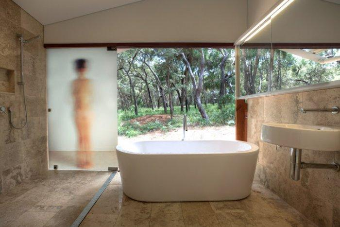 Stylish small bathroom with a view to the nature in Australia