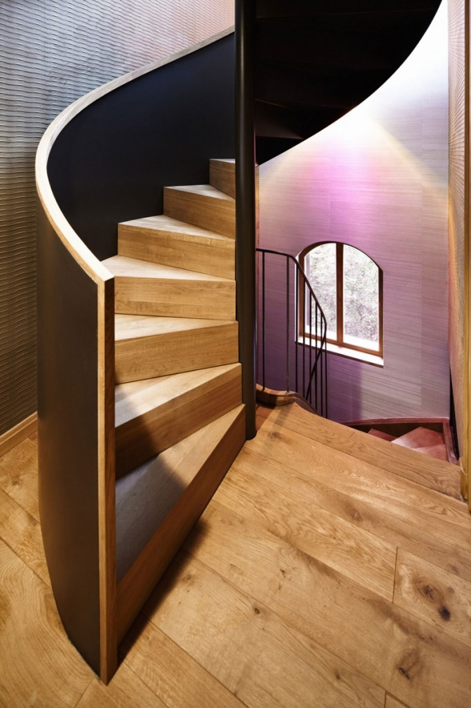 The wooden staircase leading to the upper floor - The Contemporary Design of a Three Story Building