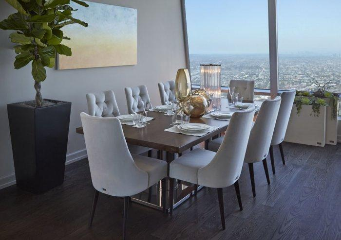 Walnut dining table and 8 white chairs in Luxury Los Angeles Penthouse in Ritz-Carlton Residences