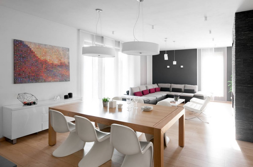 Walnut dining table with 6 Panton chairs - Contemporary Family House in Poland with Minimalist Touch