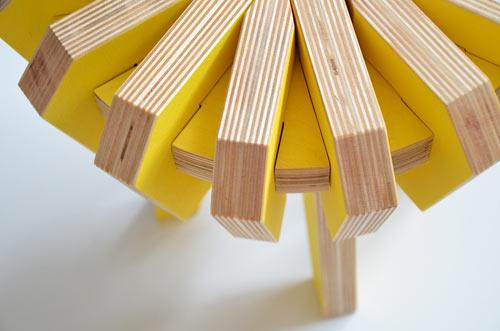 Yellow stool with wooden details - The Puzzle Stool