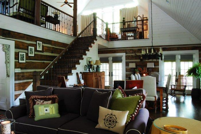 Brown sofa with decorative cushions - The Rustic Interior Design of a Mountain Log Cabin in Alabama