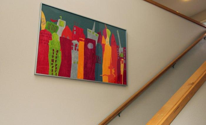 Children painting hanged on the living room wall - Modern and Cozy Family Home in Portland, Oregon