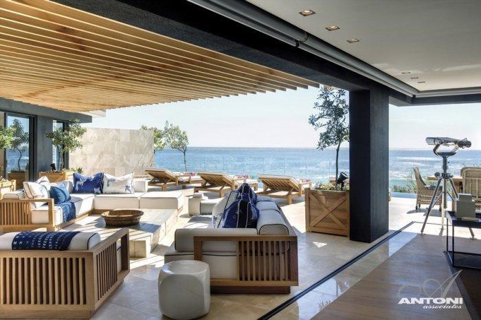Contemporary patio furniture used at luxury terrace - Impressive Minimalist Beachfront Apartment by ANTONI ASSOCIATES