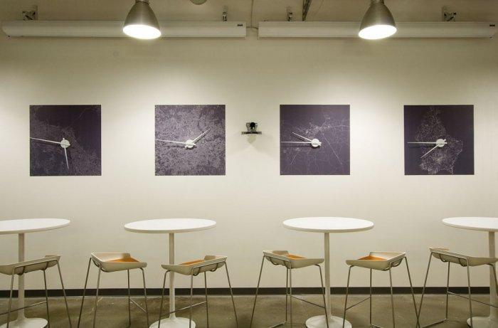 Creative world clocks hanging on the wall - Skype HQ's Modern Office in California - by Design Blitz