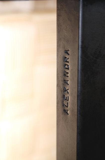 Name engraved on a table leg - Modern and Cozy Family Home in Portland, Oregon