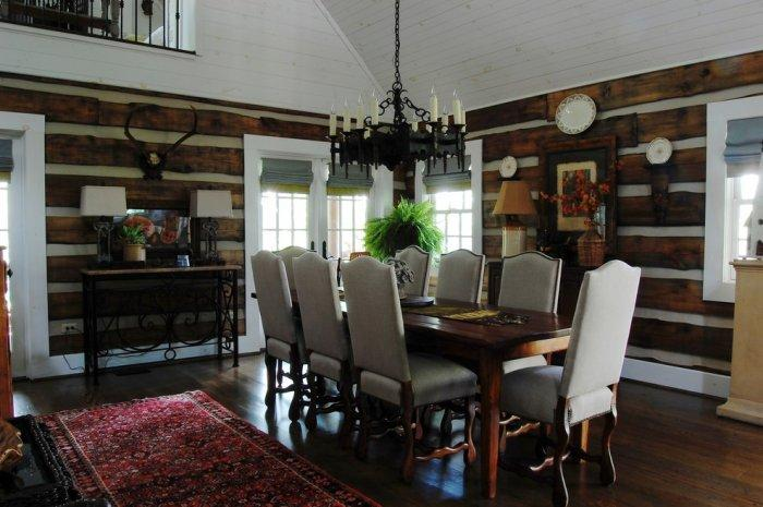 Pine wood dinner table with a set of 8 chairs - The Rustic Interior Design of a Mountain Log Cabin in Alabama
