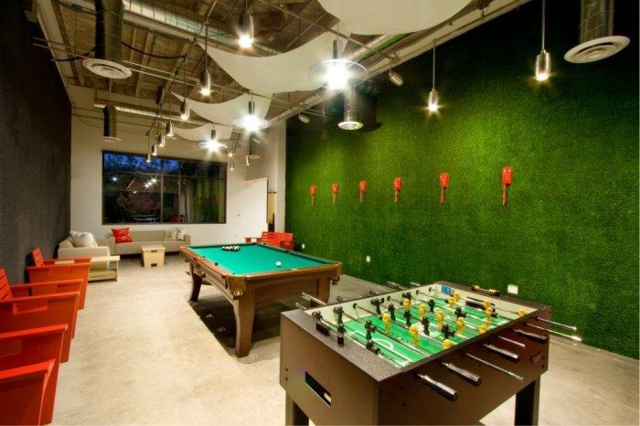 Relax room with football games - Skype HQ's Modern Office in California - by Design Blitz