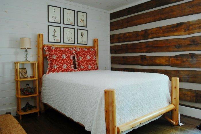 Rustic bed placed in a small bedroom - The Interior Design of a Mountain Log Cabin in Alabama