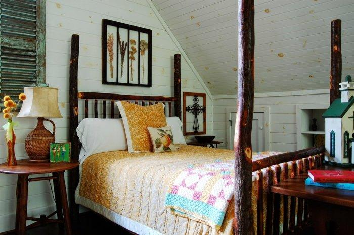 Rustic bed with floral decoration above it - The Rustic Interior Design of a Mountain Log Cabin in Alabama
