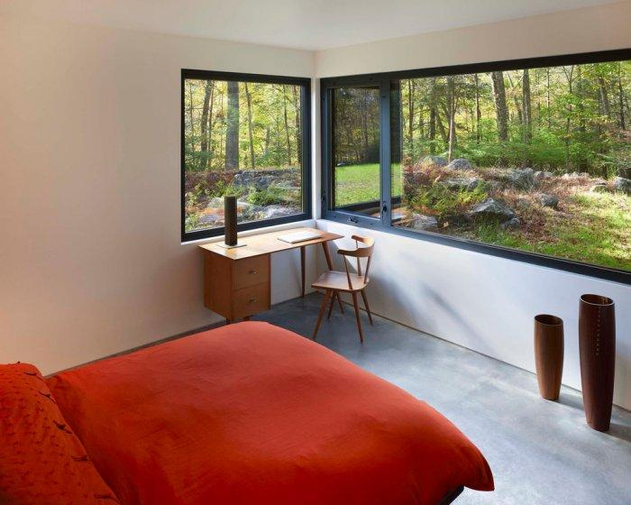 Small bedroom with red bed - The Modern Architecture of a Weekend House by Chan-Li Lin