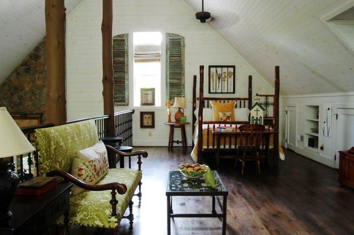 Stylish vintage small couch and a table in front of it - The Rustic Interior Design of a Mountain Log Cabin in Alabama