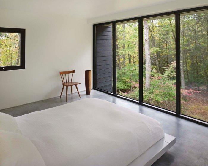 The master bedroom is in white and has a beautiful scenery - Weekend House by Chan-Li Lin