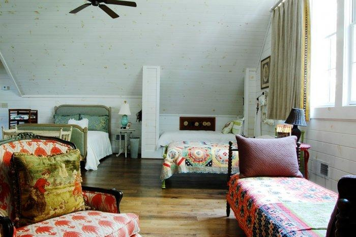 Vintage colorful single beds- The Rustic Interior Design of a Mountain Log Cabin in Alabama