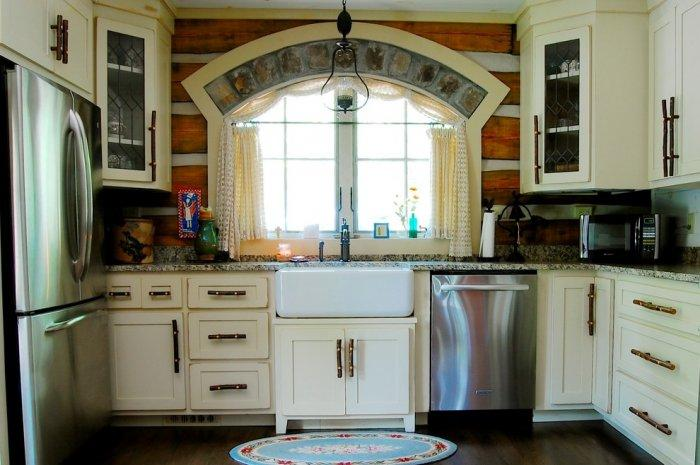 Vintage kitchen with rustic white cabinets - The Interior Design of a Mountain Log Cabin in Alabama