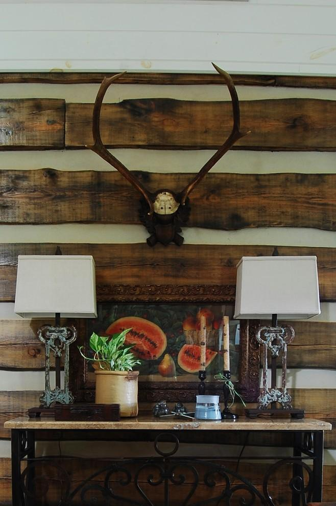 Wall mounted antlers - The Rustic Interior Design of a Mountain Log Cabin in Alabama