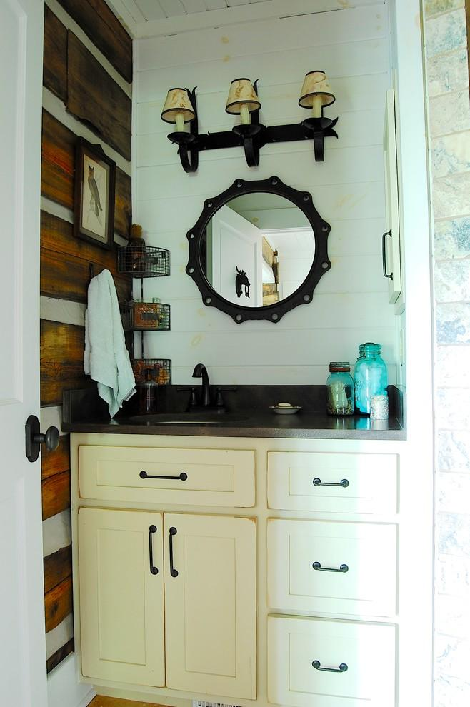 White bathroom cabinets and vintage mirror - The Rustic Interior Design of a Mountain Log Cabin in Alabama