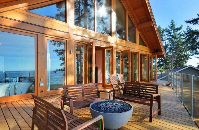 There is a 45 foot wooden deck at the back of the coastal house - The Dream House With Heavenly Ocean Views