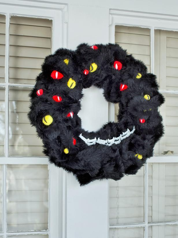 Black monster Halloween wreath - with colofrul eyes and vampire teeth