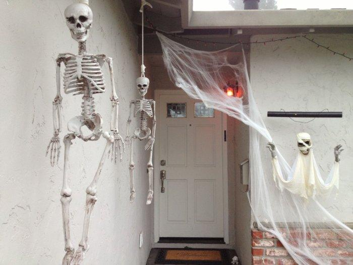 Hanging Halloween skeletons - and white spider nets