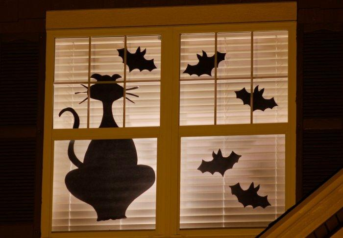 Mouse and bat decals - placed on the window