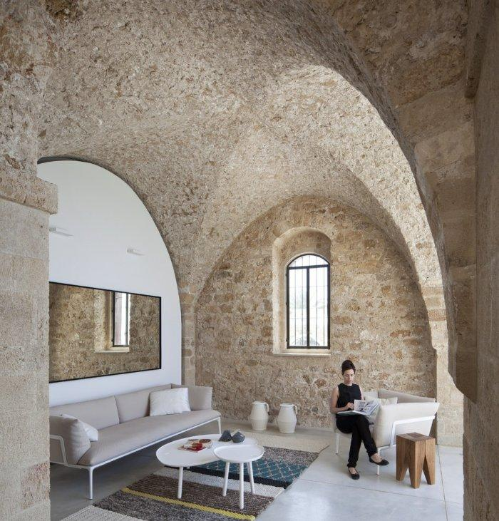 Ancient stone structure inside a Spectacular Ancient Seaside Penthouse in Tel Aviv