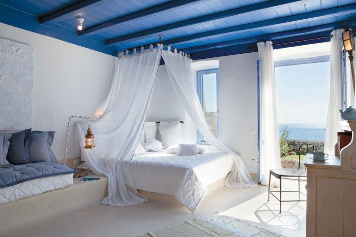 Beautiful airy white and blue master bedroom overlooking the sea - The Paradise Seaside Mediterranean Villa in Mykonos, Greece
