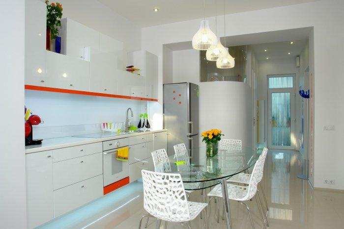 Contemporary kitchen design with colorful accents - a Family Apartment in Budapest