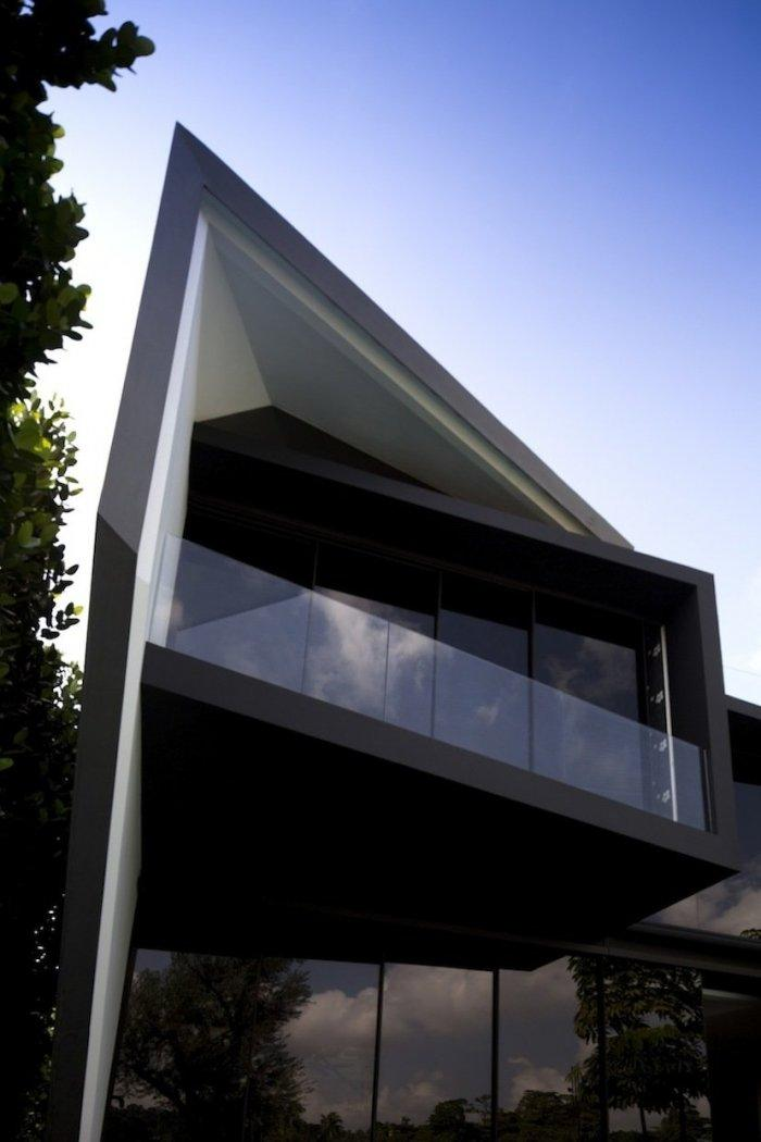 Terrace with glass railings and darks tones - The Contemporary Diamond House by Formwerkz Architects