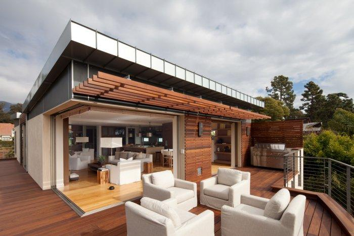 Contemporary white front porch furniture - High-End Ecofriendly Luxury House in Montecito, California