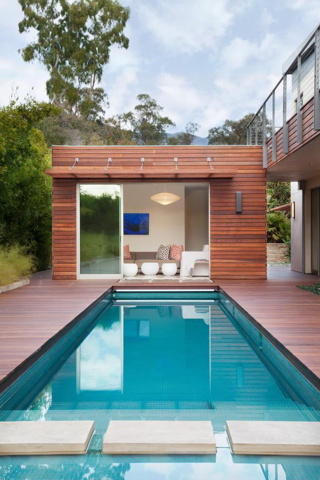 Crystal blue swimming pool and a small lounge house - High-End Ecofriendly Luxury House in Montecito, California