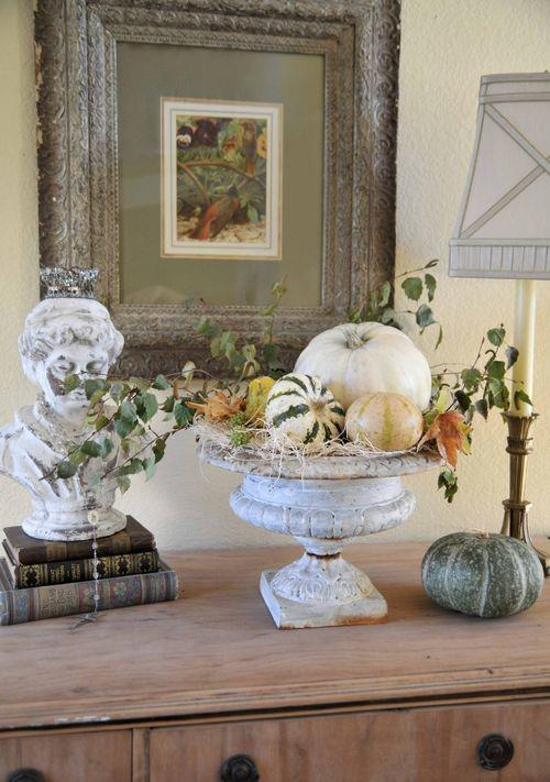 Decorative pumpkins placed in an antique vase standing on a vintage cupboard - 36 Ideas for Your Home