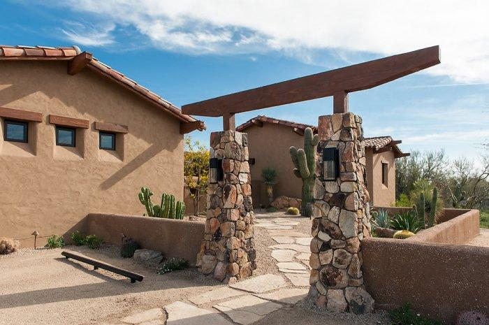 Entry gate with wood barn beams - Luxury Rustic Family Desert House in Arizona
