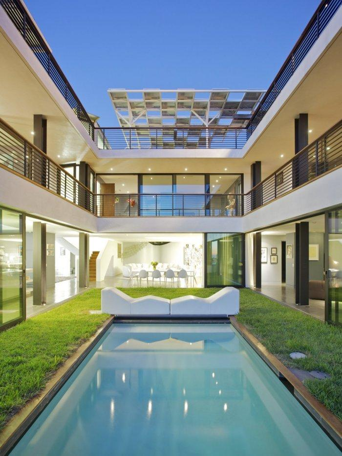 Inner enclosed garden with luxury swimming pool in a White Two-Storey House in Los Angeles, California