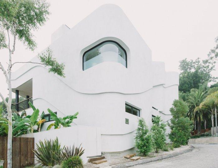 Luxury White Two-Storey House with rounded corner window in Los Angeles, California