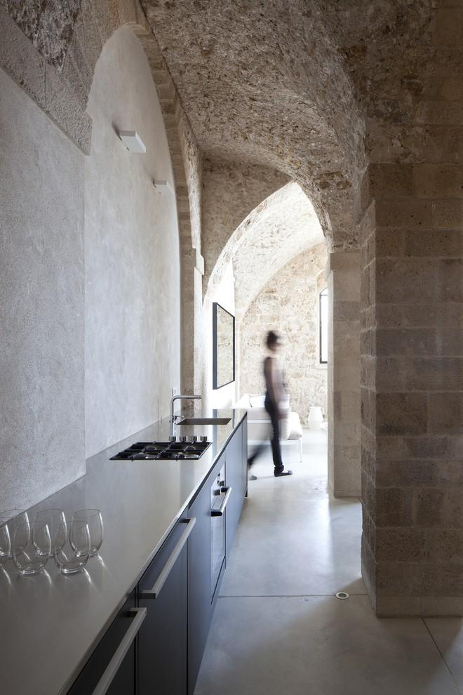 Minimalist kitchen design in an apartment - Spectacular Ancient Seaside Penthouse in Tel Aviv