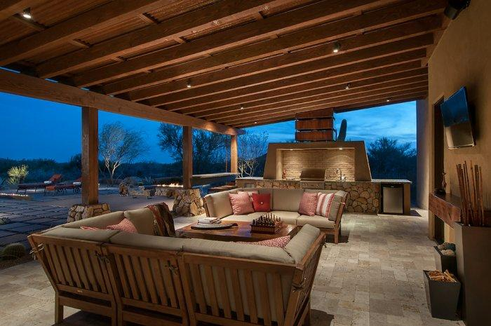 Open kitchen with barbecue area and comfortable patio furniture in a Luxury Rustic Family Desert House in Arizona
