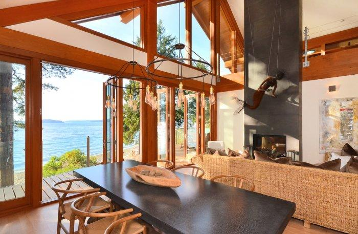 Open space timber living room overlooking the ocean - The Dream Coastal House