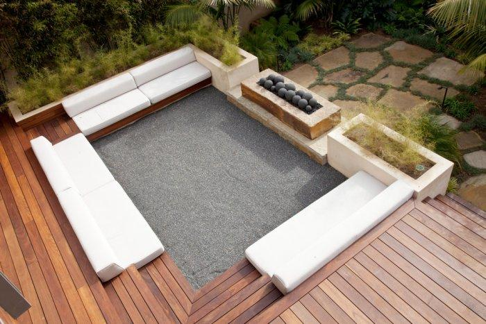 Outdoor lounge area with comfortable white furniture - High-End Ecofriendly Luxury House in Montecito, California